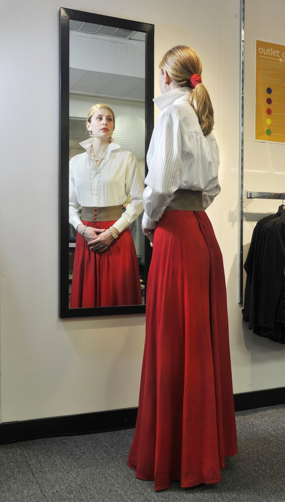 A model wears the outfit that designer Jill McGowan would choose for close, a white poet's shirt paired with a vintage Valentino skirt.