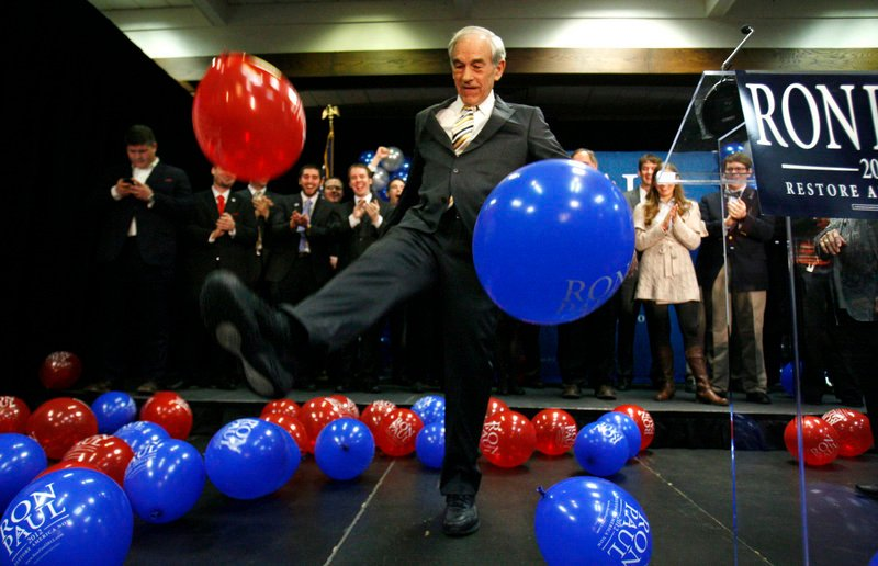Rep. Ron Paul kicks balloons after speaking to supporters in Portland last Saturday after his loss in the Maine caucuses to Mitt Romney. Paul was reported the winner in the Portland caucus last weekend, but the recount gives the win to Romney.