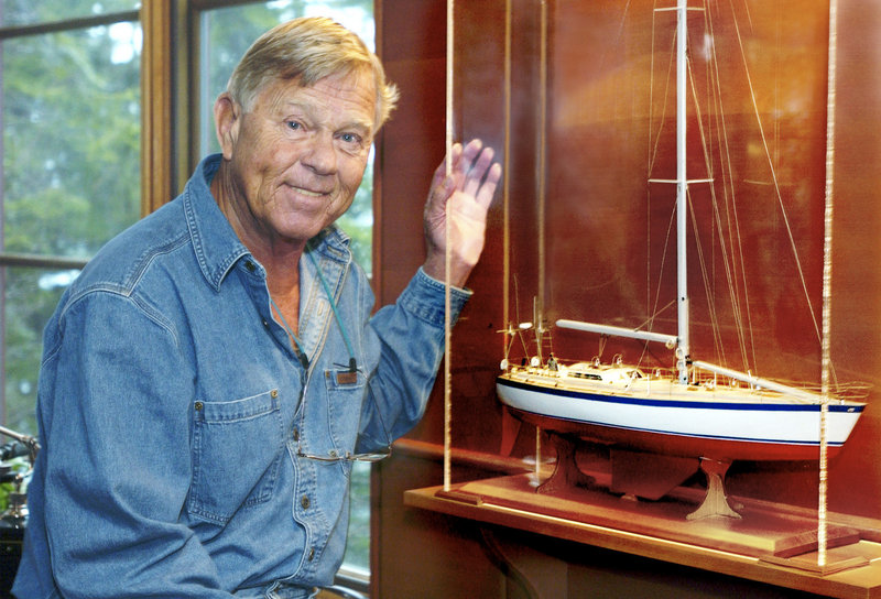 Dodge Morgan stands next to a model of his boat, American Promise. He sailed the boat around the world solo 26 years ago. The Maine businessman died in 2010 at the age of 78.