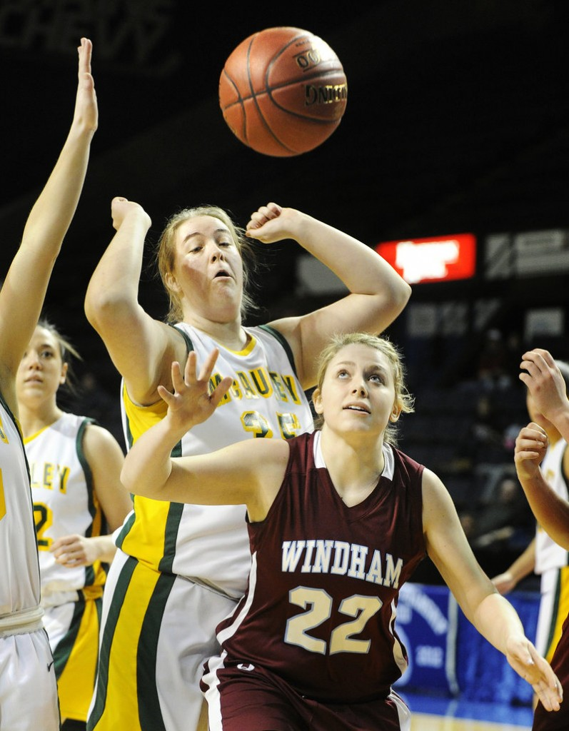 The ball bounces free in front of Lauren Coughlin of Windham and Kathryn Liziewski of McAuley. McAuley won, 49-33.