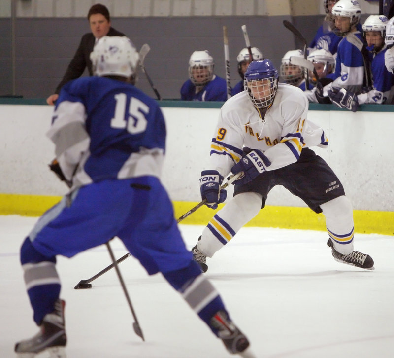 Ben Freeman of Falmouth looks for an opening past Cam Wiewel of Kennebunk during the first period of Falmouth's 10-1 victory Tuesday night in a Western Class A quarterfinal.