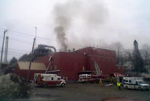 More than twenty firefighters, including ones with ladder trucks, are working to extinguish a fire at the Geneva Wood Fuels pellet mill in Strong.