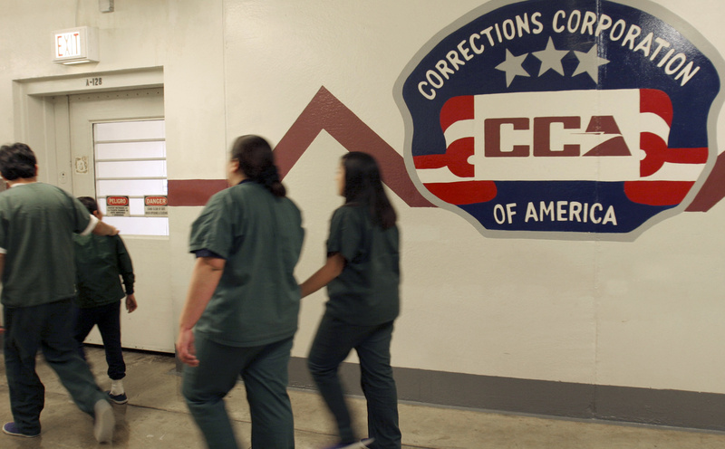 Immigrant detainees walk down a hall at the T. Don Hutto Residential Center, a Corrections Corporation of America facility in Taylor, Texas, in 2007. CCA wants to capitalize on the deal it made with the state of Ohio to buy the Lake Erie Correctional Institution, the first state prison to be bought by a private firm.