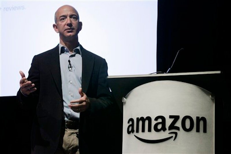 In this photo from May 25, 2010, Amazon.com Inc. CEO and founder Jeff Bezos speaks during the company's shareholders meeting in Seattle. An undersea expedition spearheaded by Bezos used sonar to find what he said were the F-1 engines that helped boost the Apollo 11 mission to the moon located 14,000 feet deep in the Atlantic. (AP Photo/Ted S. Warren)