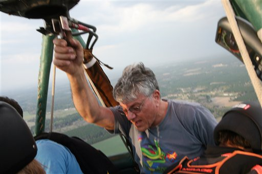 In this Friday, March 16, photo provided by Brian Wesnofske, pilot Ed Ristaino, 63, speaks to skydivers in his hot-air balloon over Fitzgerald, Ga. Later, Ristaino would tell his five passengers to bail out just before a thunderstorm sucked in his craft and sent him plummeting to his death.
