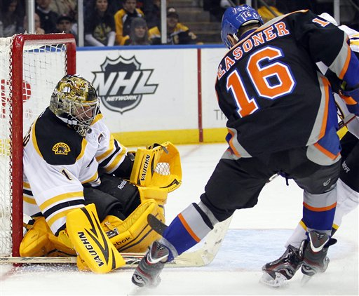Boston Bruins goalie Marty Turco (1) makes a save on a shot by New York Islanders Marty Reasoner (16) during the second period of an NHL hockey game at the Nassau Coliseum in Uniondale, N.Y. on Saturday, March 31, 2012. The Bruins won 6-3.P Photo/Paul J. Bereswill) Bruins Islanders Hockey