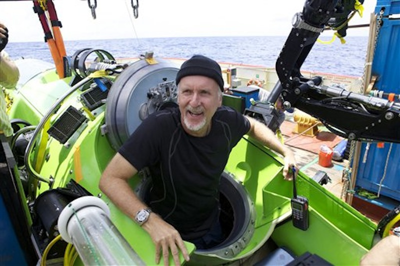 Filmmaker and National Geographic Explorer-in-Residence James Cameron emerges from the Deepsea Challenger submersible after his successful solo dive to the Mariana Trench, the deepest part of the ocean, Monday March 26, 2011. (AP Photo/Mark Theissen, National Geographic) MM8108