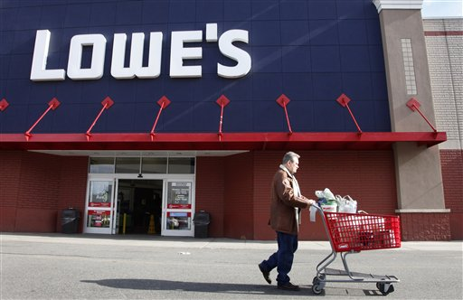 A customer exits a Lowe's store in New York.