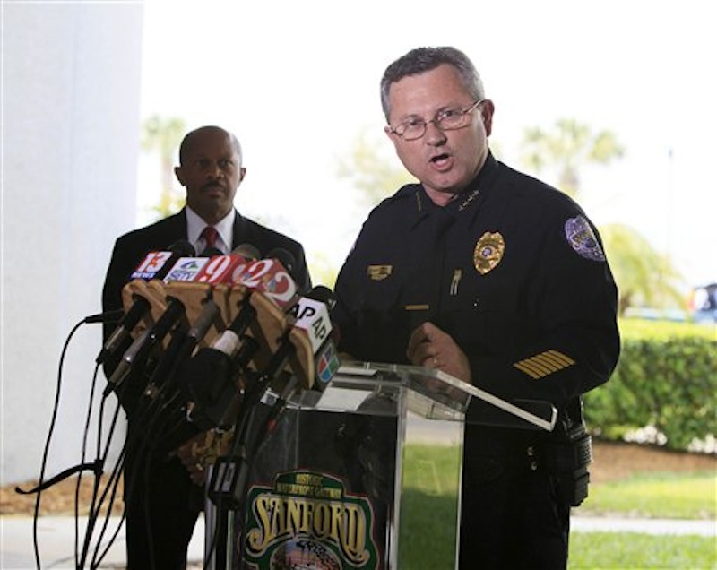 Sanford Police Chief Bill Lee speaks to the the media during a news conference Thursday, March 22, 2012 as city manager Norton Bonaparte Jr. listens at left, in Sanford, Fla. Lee, who has been bitterly criticized for not arresting a neighborhood watch volunteer in the shooting death of an unarmed black teenager, announced that he is temporarily stepping down to let passions cool. (AP Photo/Julie Fletcher)