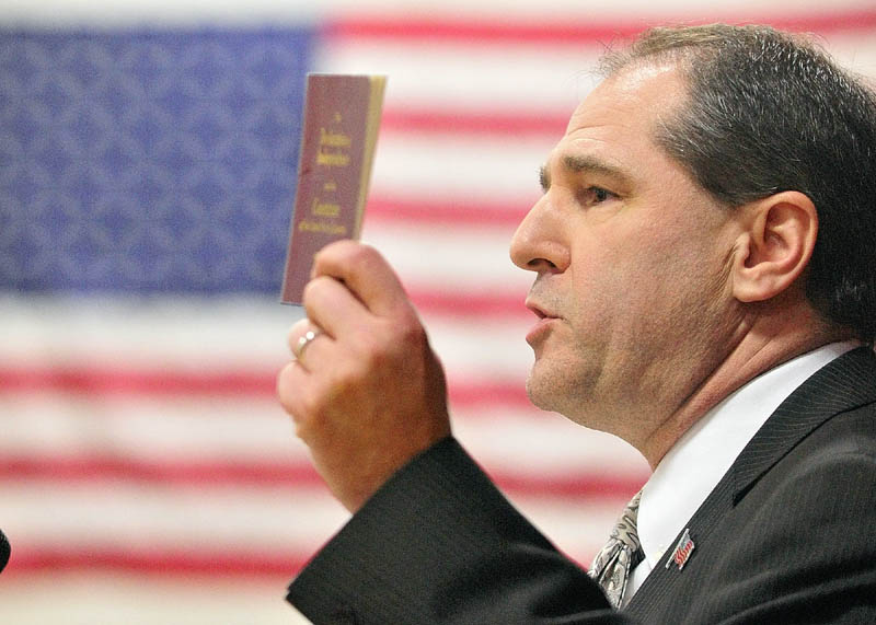 Republican Senate hopeful Scott D'Amboise waves his copy of the Declaration of Independence and the U.S. Constitution at the Maine Republican Caususes in Augusta last month. D'Amboise is running to replace Sen. Olympia Snowe.