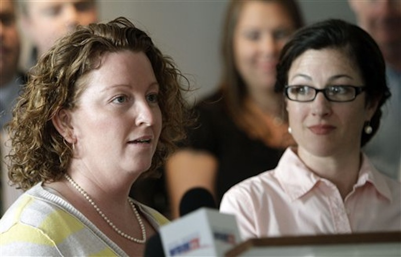 Emily French-Dumont, right listens as her partner Mary Dumont talks against a bill to repeal the law allowing same-sex marriage during a news conference on Monday, March 19, 2012 in Concord, N.H. The House votes later this week on a bill to repeal the law allowing same-sex marriages. (AP Photo/Jim Cole)