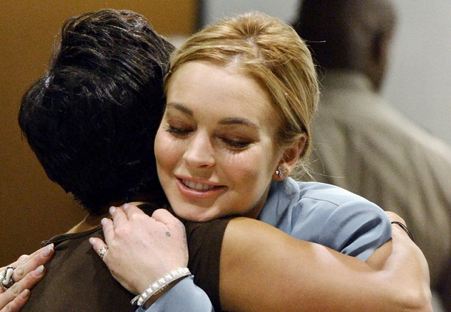 Lindsay Lohan embraces her attorney after a progress report on her probation at Los Angeles Superior Court Thursday. The judge told her to focus on her work.