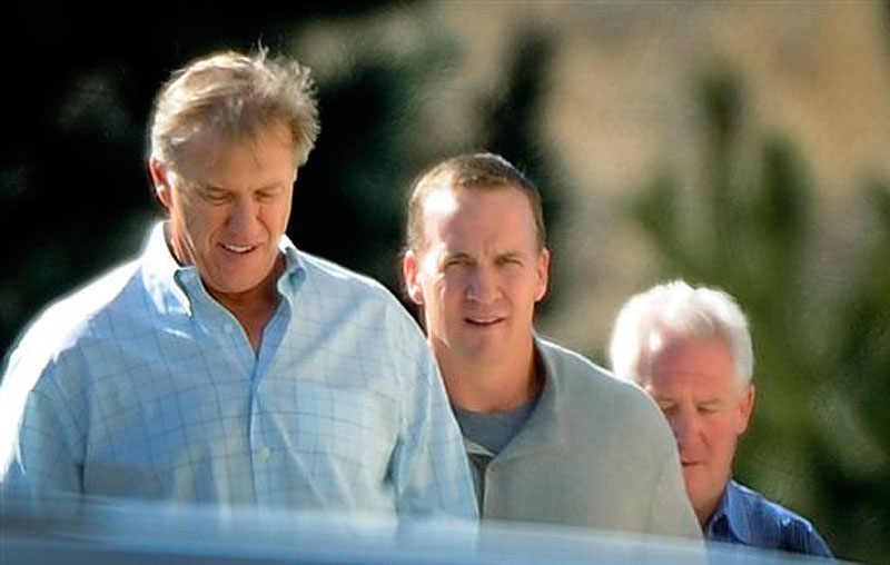 NFL quarterback Peyton Manning, center, takes a tour with executive vice president of football operations for the Denver Broncos John Elway, left, and Broncos coach John Fox at the Broncos' training facility in Englewood, Colo. on Friday, March 9, 2012. Four-time MVP Manning opened his free-agency tour of NFL suitors Friday. (AP Photo/The Denver Post, John Leyba)