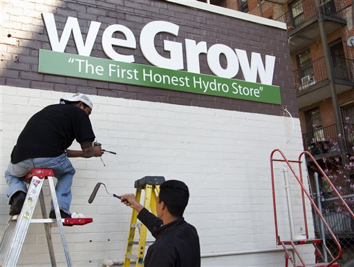 Workers put finishing touches on the exterior of the weGrow store in northeast Washington today in preparation for its Friday opening.