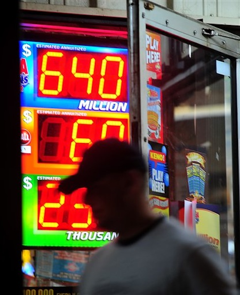 A customer walks out of the Riverside Travel Center in Hilton, Ga., late Friday night after purchasing a lottery ticket for the Mega Millions Lottery which reached an estimated record jackpot of $640 million for Friday night's drawing. (AP Photo/Jay Hare, The Eagle) MEGAMILLIONS LOTTERY