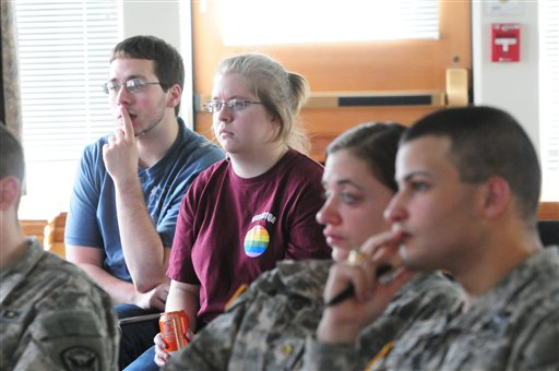 Norwich University students, from left, Brian Loveless, 20, Hailey Libbey, 19, Mary Andreo, 22, and Joshua Fontanez, 22, attend a meeting of the Lesbian, Gay, Bisexual, Transgender, Questioning, and Allies Club on Monday.