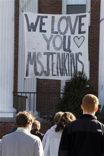 A banner hangs at St. Johnsbury Academy on Tuesday, March 27, 2012 in St. Johnsbury, Vt. The discovery of a body Monday believed to be that of Melissa Jenkins, a beloved teacher at the boarding school, sent shudders of grief and anxiety through the small New England town a day after her SUV was found running with her unharmed 2-year-old boy inside. Jenkins, a 33-year-old single mother, taught science at St. Johnsbury Academy. (AP Photo/Toby Talbot)