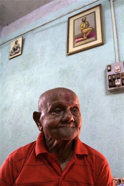 Indian body builder Manohar Aich looks on at his residence in Kolkata, India on Sunday, March 18, 2012. Aich, who is only 4 foot 11 inches (150 centimeters) tall, won the Mr. Universe title in London way back in 1952. Happiness and a life without tensions are the key to his longevity, said Aich, who turned 100 on March 17. (AP Photo/Bikas Das)