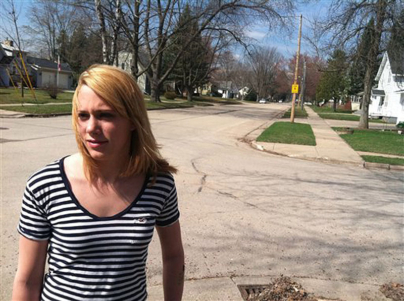 Jordan Pfeiler talks about the mystery booms she's heard over the past few days as she stands outside her house Wednesday, March 21, 2012, in Clintonville, Wis. City officials are trying to record the mysterious booming sounds that have roused residents from their beds, sometimes still in pajamas, but their attempts have so far come up empty. (AP Photo/Carrie Antlfinger)
