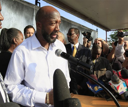 Tracy Martin, father of shooting victim Trayvon Martin, speaks to thousands gathered before a rally at Fort Mellon Park in Sanford, Fla., on Thursday.