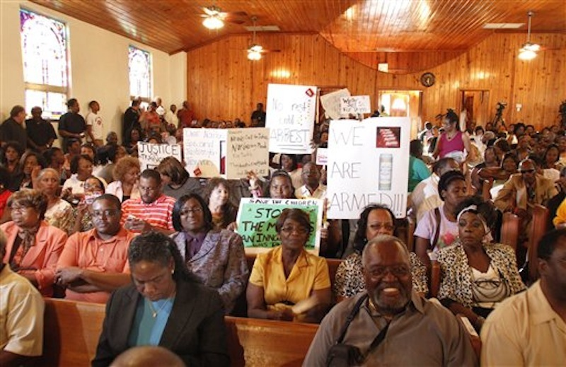 A group gathers in a church and chants