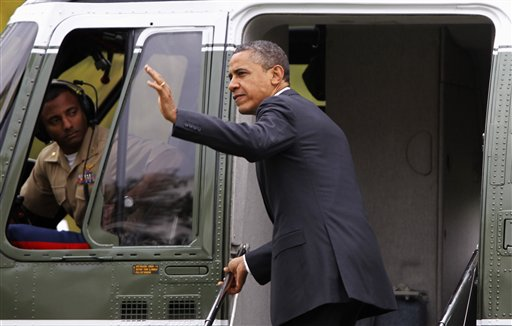 President Barack Obama waves as he boards the Marine One helicopter on the South Lawn of the White House today to begin his trip to Vermont and Maine for campaign fundraising events.