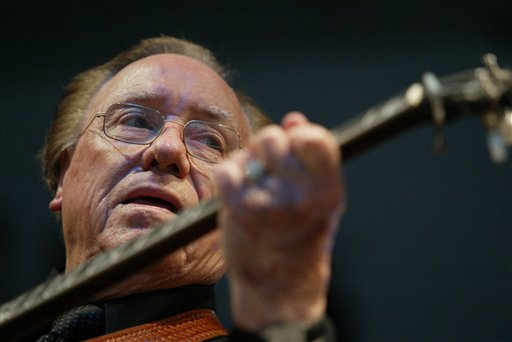 A June 10, 2005, photo of Earl Scruggs performing at the Bonnaroo Music & Arts Festival in Manchester, Tenn.