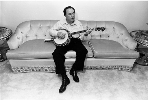 In this photo 1982 photo, bluegrass legend and banjo pioneer Earl Scruggs plays his banjo.