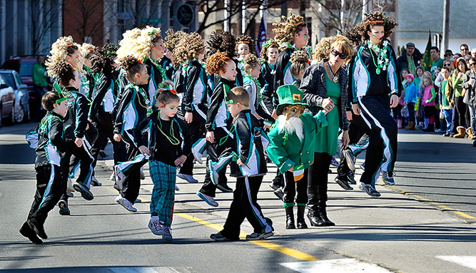 Members of the Stillson School of Irish Dance entertain the parade watchers during the Irish Parade on Commercial Street on Saturday, March 17, 2012.