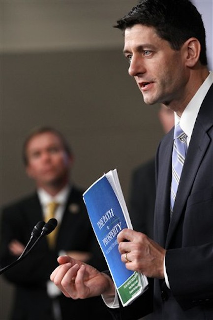 House Budget Committee Chairman Rep. Paul Ryan, R-Wis. holds a copy of his budget plan entitled