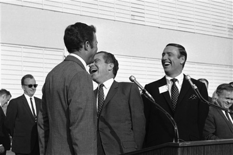 In this Oct. 10, 1968 photo, Republican presidential candidate Richard Nixon, center, laughs at something comedian Dick Martin, right, says, during a rally in Burbank, Calif., Oct. 10, 1968. Some decidedly unfunny candidates have benefited by exceeding extremely low expectations when it comes to jokes. When Nixon went on the TV comedy show