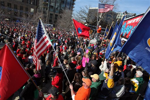 Labor groups and others rally in front of the state capitol building in Madison, Wis. to recall Wisconsin Gov. Scott Walker in this March 10, 2012, photo.
