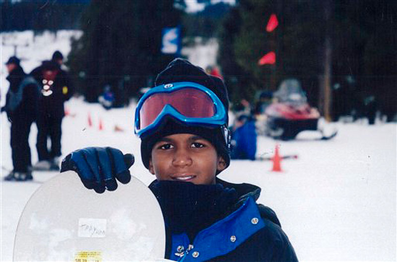 This undated file photo provided by the Martin family, shows Trayvon Martin snowboarding. Martin was slain in the town of Sanford, Fla., on Feb. 26 in a shooting that has set off a nationwide furor over race and justice. Neighborhood crime-watch captain George Zimmerman claimed self-defense and has not been arrested, though state and federal authorities are still investigating. Since the slaying, a portrait has emerged of Martin as a laid-back young man who loved sports, was extremely close to his father, liked to crack jokes with friends and, according to a lawyer for his family, had never been in trouble with the law. (AP Photo/Martin Family, File)