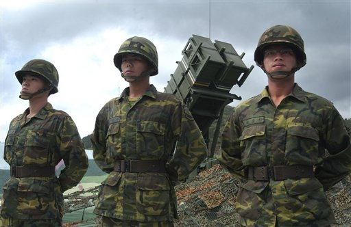Taiwanese soldiers stand in front of a U.S.-made Patriot missile air defense system near the northern coastal town of Wanli, Taiwan, in this 2004 photo.
