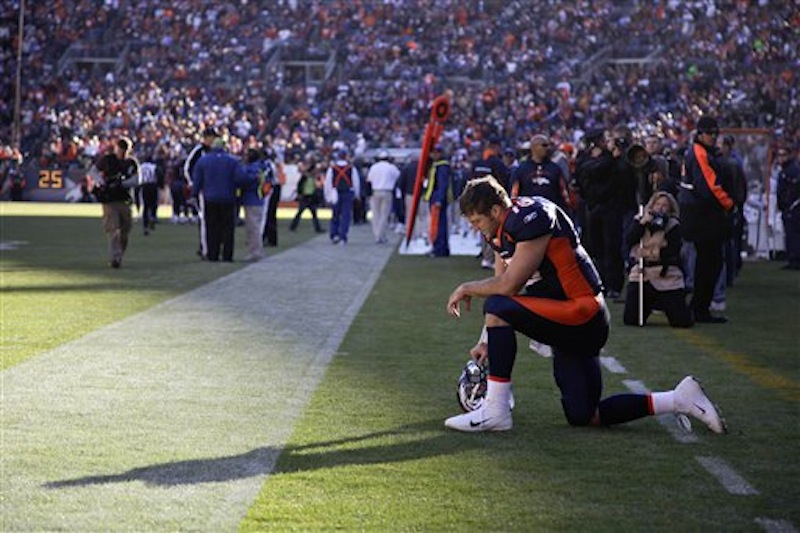 In this Dec. 11 photo, Denver Broncos quarterback Tim Tebow prays in the end zone before the start of a game against the Chicago Bears. Tebow was traded to the New York Jets on Wednesday, March 21, 2012. (AP Photo/Julie Jacobson)