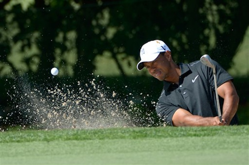 Tiger Woods hits out of a green-side bunker on the first hole during the first round of the Arnold Palmer Invitational golf tournament at Bay Hill in Orlando, Fla. on Thursday, March 22, 2012.(AP Photo/Phelan M. Ebenhack)