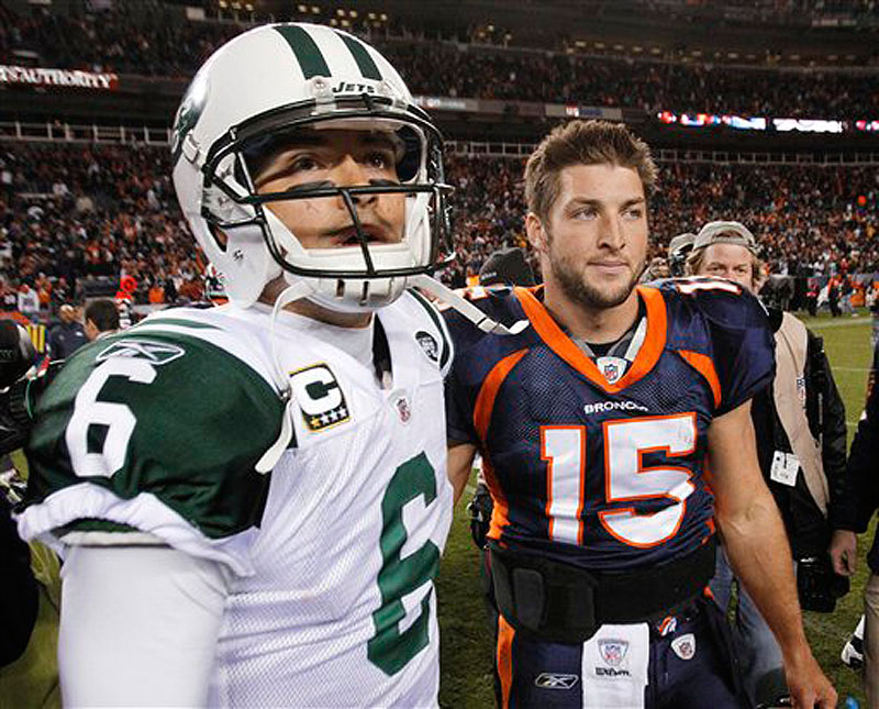 In this Nov. 17, 2011 photo, New York Jets quarterback Mark Sanchez (6) and Denver Broncos quarterback Tim Tebow (15) walk off the field together after an NFL football game, in Denver.