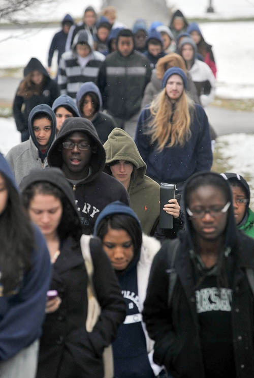 Colby College students wear hooded sweatshirts and jackets in symbolic support of Trayvon Martin as they march across the Colby campus in Waterville today.