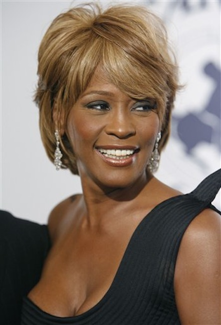 In this Oct. 28, 2006 photo, musician Whitney Houston arrives at the 17th Carousel of Hope Ball benefiting the Barbara Davis Center for Childhood Diabetes in Beverly Hills, Calif. Coroner's officials said Thursday, March 22, 2012, that Houston drowned, but her death was also caused by heart disease and cocaine use that suggested she was chronically using the drug. Houston died Feb. 11, in California at the age of 48. (AP Photo/Matt Sayles)