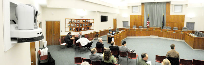 This composite made from two photos shows the City Council Chamber in Augusta's City Center which features four remote control video cameras like the one at far left used to show meetings held there.