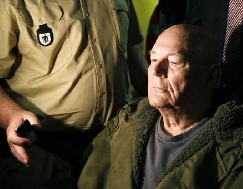 John Demjanjuk leaves a courtroom Thursday in Munich, Germany. He was sentenced to five years in prison on 28,060 counts of accessory to murder for the number of people who were killed in the Sobibor death camp. He was released pending an appeal of his conviction.