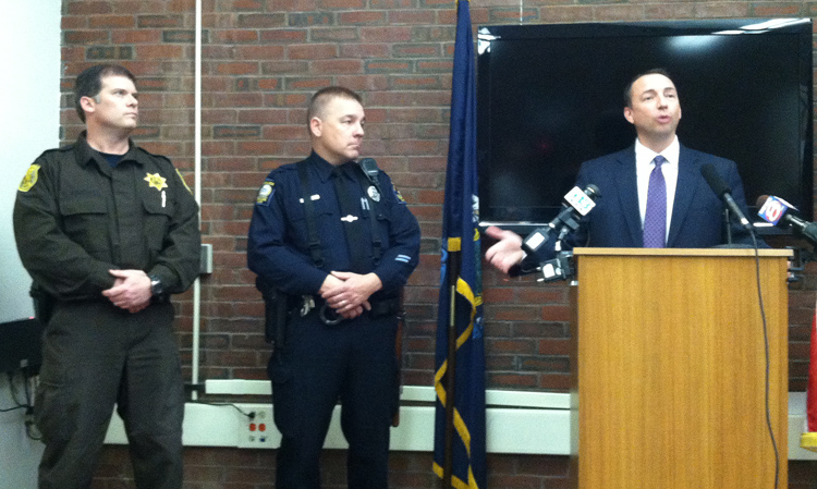 Sheriff's Deputy Richard Kimball, left, and Portland Officer Dan Rose, center, are praised by Portland Police Chief Michael Sauschuck during a news conference on Wednesday.