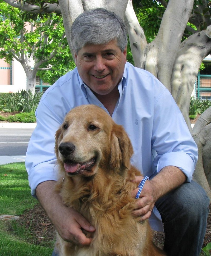 David Rosenfelt and one of his 28 rescued dogs.