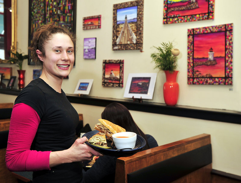 Michelle Pickrell delivers a patron's Cuban sandwich with soup during a recent lunchtime.