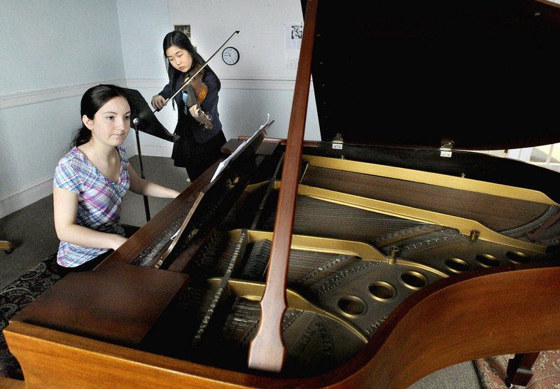 Kelia Ingraham, on piano, and Seoyeon Kim rehearse at the Portland Conservatory of Music. The two are among the nine young artists enrolled in the conservatory's Krager Scholars program.