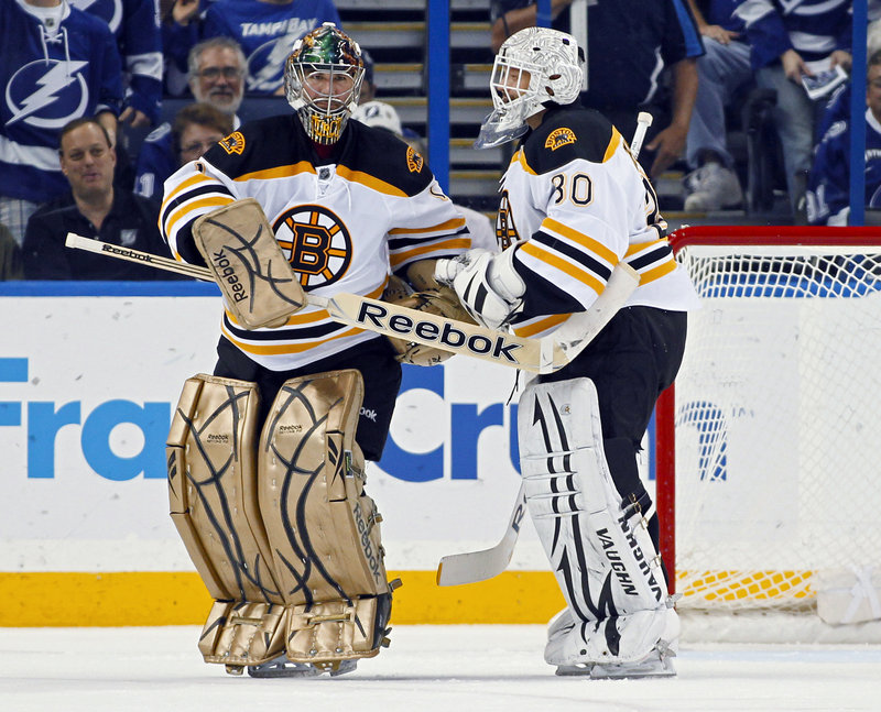 Maybe the Bruins should have used both goalies at the same time Tuesday night. Marty Turco, left, started and was replaced by Tim Thomas, who was also ineffective. Tampa Bay scored on 6 of 17 shots in beating the Bruins.