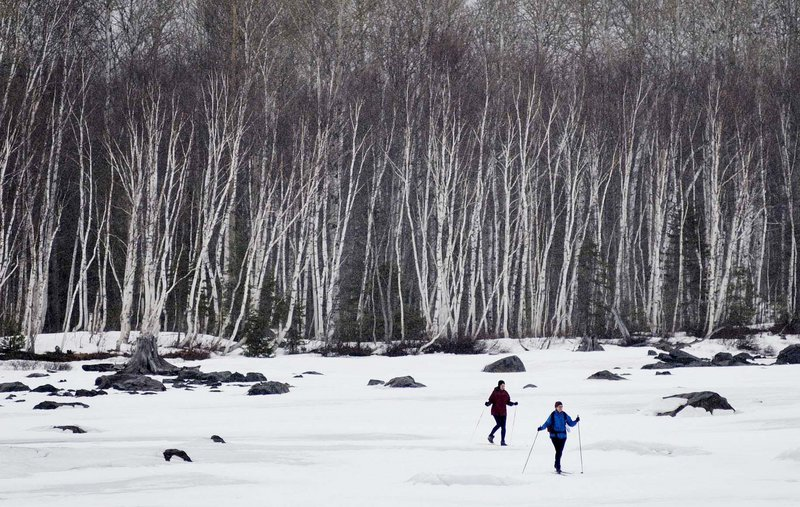 Tricia Deering, left, and Linda Laird, both of New Jersey, ski across a section of Flagstaff Lake with birch trees as their backdrop. The two were part of a four-person group that took advantage of Maine Huts and Trails, which is bringing enthusiasts to the outdoors of western Maine.