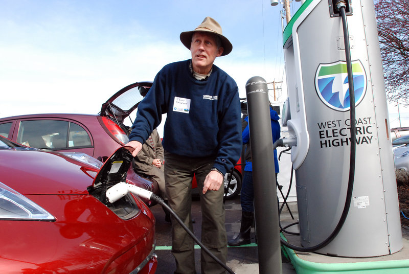 Bruce Sargent of Ashland, Ore., tops off the charge on his Nissan Leaf on Friday at a new electric car charging station in Central Point, Ore. The station is one of eight along a 160-mile section of Interstate 5.