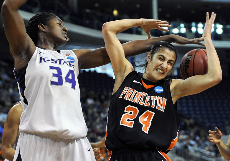 Branshea Brown of Kansas State knocks the ball away from Princeton's Niveen Rasheed during their NCAA first-round game Saturday at Bridgeport, Conn. Kansas State won, 67-64.