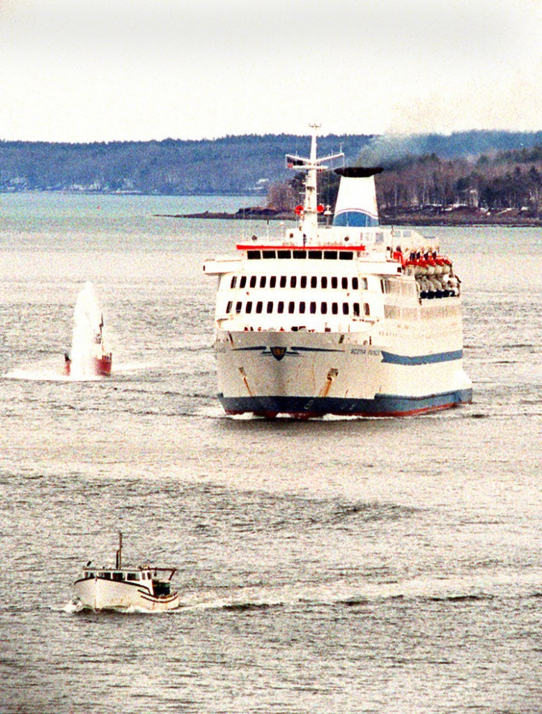 The Scotia Prince cruises into Portland Harbor with a fireboat escort to dock at the International Marine Terminal in April 2001.